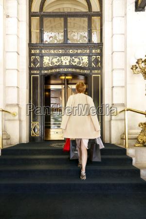 glamorous caucasian woman carrying shopping bags