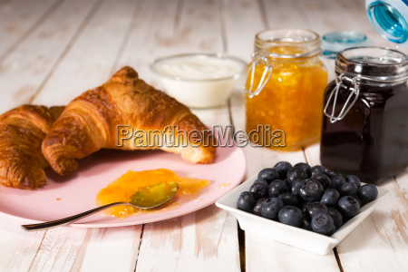 breakfast with croissant over a wooden