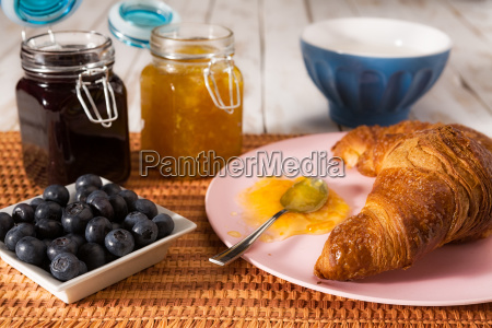 breakfast with croissant and blueberries over