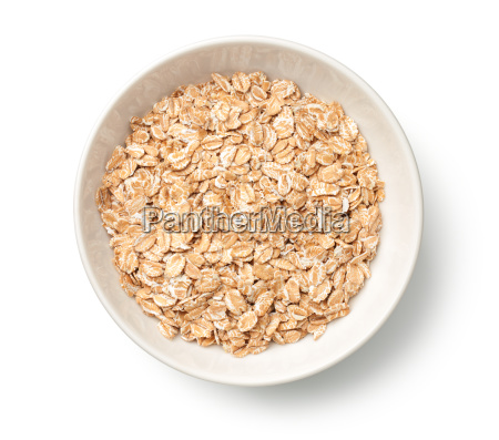 oat rye flakes in bowl isolated