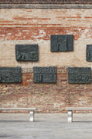 venetian ghetto wall with carved reliefs