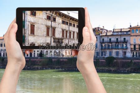 tourist photographs houses in verona city