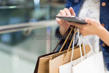 shopping woman using cellphone