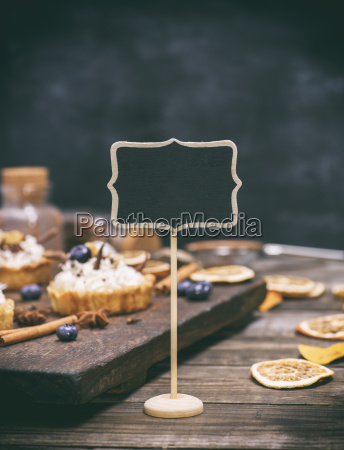 empty wooden sign with a black