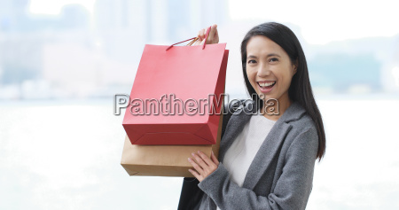 happy woman go shopping and holding