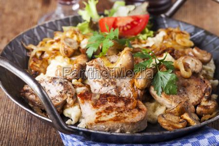 pork fillet on spaetzle with mushrooms