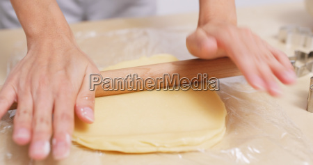 dough with a rolling pin
