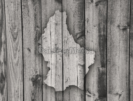 map of luxembourg on weathered wood