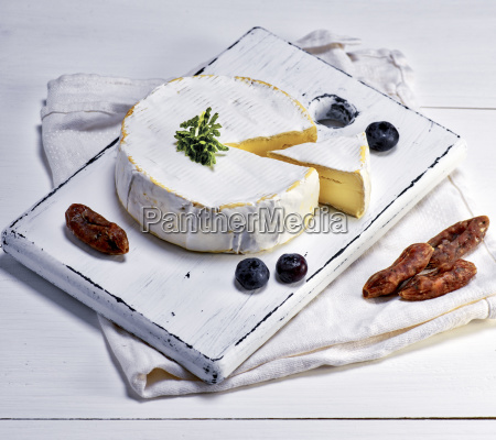 camembert cheese and pieces of smoked