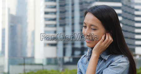 woman listen to music on earphone