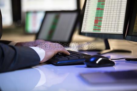 stock market broker working on computer