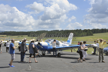 small plane parked on the mende