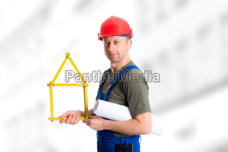 friendly worker with yardstick house and