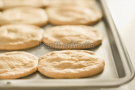 close up of cookies on sheet