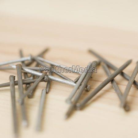 close up of nails on wood