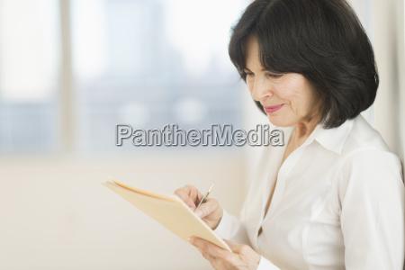 portrait of senior businesswoman writing