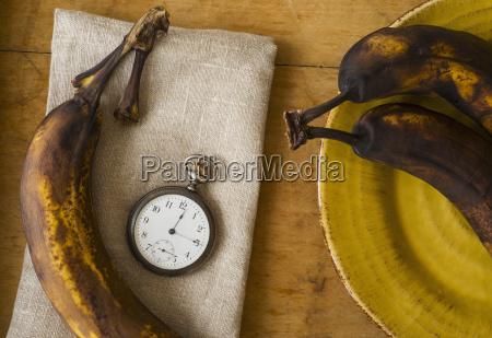 still life with bananas and pocket