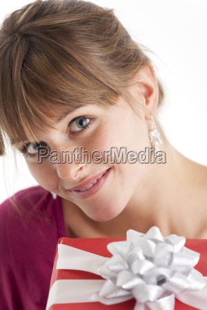 smiling woman with a gift on