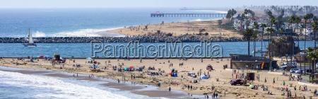 panorama of beach with visitors corona