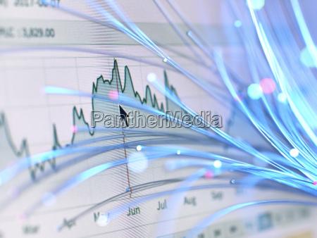 financial charts and fibre optics symbolizing