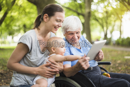 grandmother daughter and granddaughter having fun
