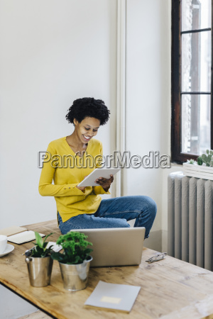 young woman at home surfing the