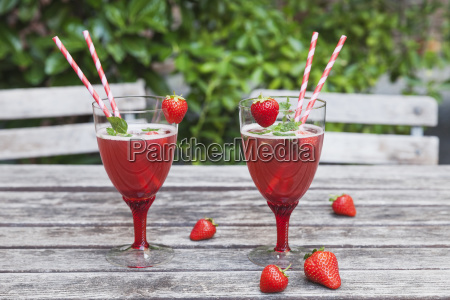 strawberry lemonade in glasses with drinking