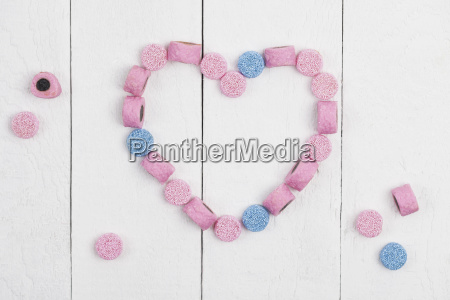 british licorice heart on wooden background