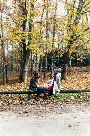 two women relaxing in an autumnal