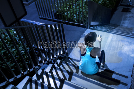 young woman sitting on stairs and