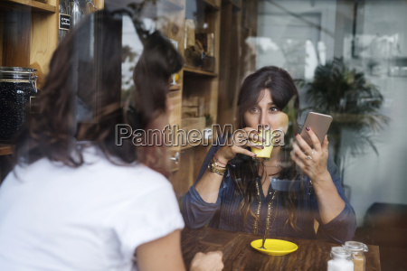 woman with friend in a cafe