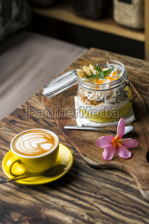 exotic muesli with flower and coffee