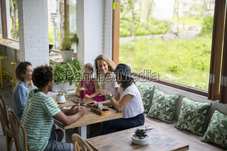 friends with child socializing in cozy