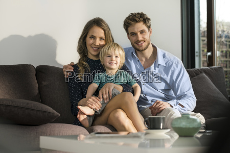 portrait of smiling parents and son