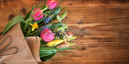bouquet of spring flowers on rustic