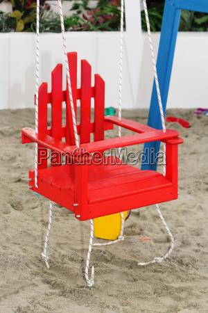 wooden child swing