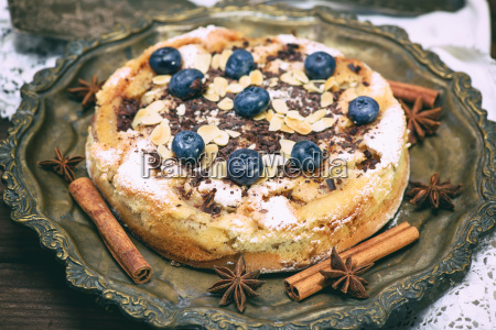 baked round cake with blueberry berries