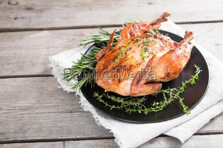 fried, whole, chicken, with, herbs, over - 24183622