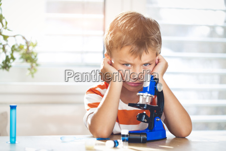 boy is frustrated while working with