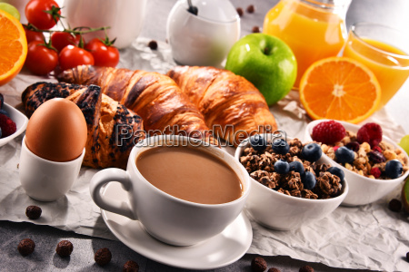 breakfast served with coffee juice croissants