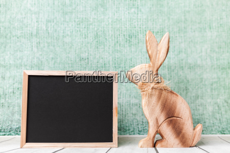 wooden easter holiday bunny and an