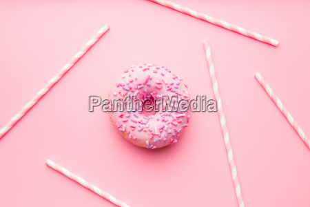 pink donut and pink straws