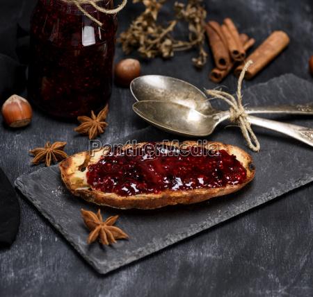 toast with raspberry jam two iron