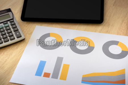 financial graph with calculator and tablet