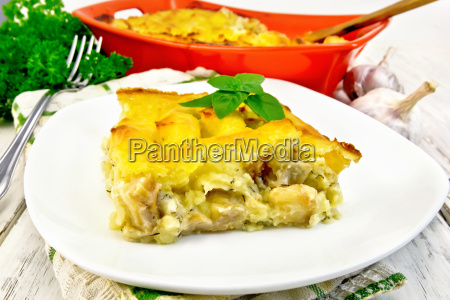 gratin potato with fish in plate