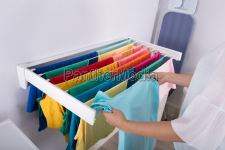 woman hanging clothes on clothes line