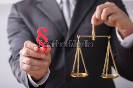 judge holding paragraph symbol and justice