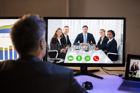 businessman video conferencing with colleagues on