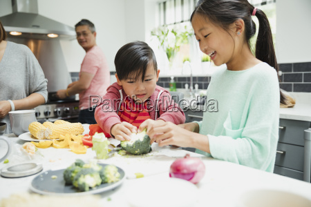 children helping to prepare dinner