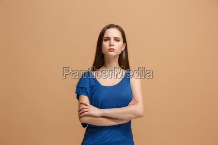 the serious woman standing and looking